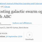 Boosting galactic swarm optimization with ABC